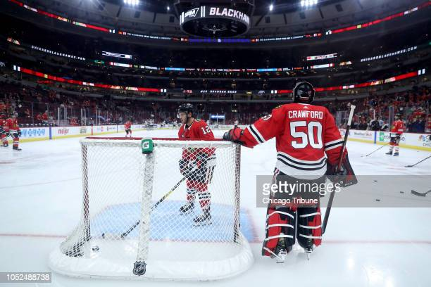 Chicago Blackhawks goaltender Corey Crawford warms up before the start play against the Arizona Coyotes at the United Center in Chicago on Thursday...