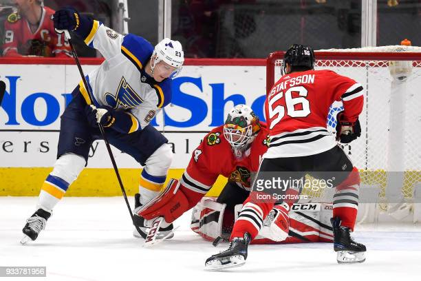 Chicago Blackhawks goaltender JF Berube battles with St Louis Blues right wing Dmitrij Jaskin to make a save in the second period of play during a...