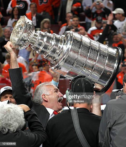 Chicago Blackhawks Head Coach Joel Quenneville celebrates with the Stanley Cup after defeating the Philadelphia Flyers 43 in overtime in Game Six of...