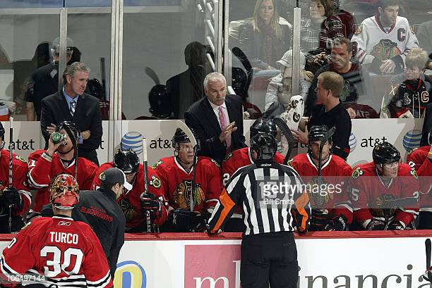 Chicago Blackhawks Head Coach Joel Quenneville talks with referee Stephane Auger during the game against the New Jersey Devils on November 03 2010 at...