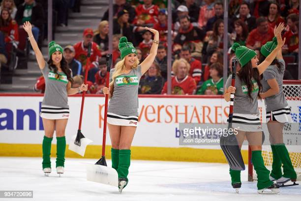Chicago Blackhawks Ice Crew girls skate the ice in their St Patricks Day themed uniform during a game between the Chicago Blackhawks and the St Louis...