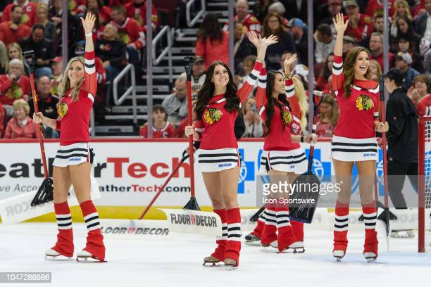 Chicago Blackhawks Ice Crew members wave to the crowd during an NHL hockey game between the Toronto Maple Leafs and the Chicago Blackhawks on October...