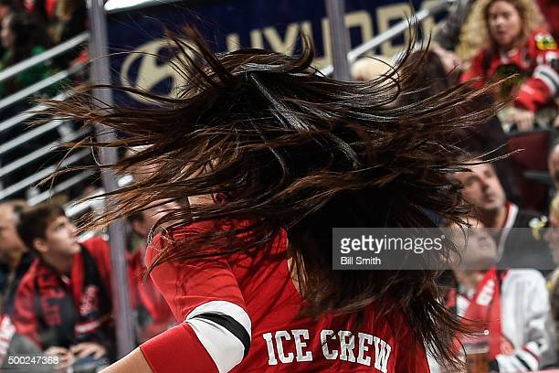 Chicago Blackhawks icecrew girl shakes her hair during the NHL game between the Chicago Blackhawks and the Winnipeg Jets at the United Center on...