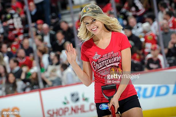 Chicago Blackhawks icecrew girl waves during the NHL game between the Chicago Blackhawks and the Minnesota Wild at the United Center on December 1...