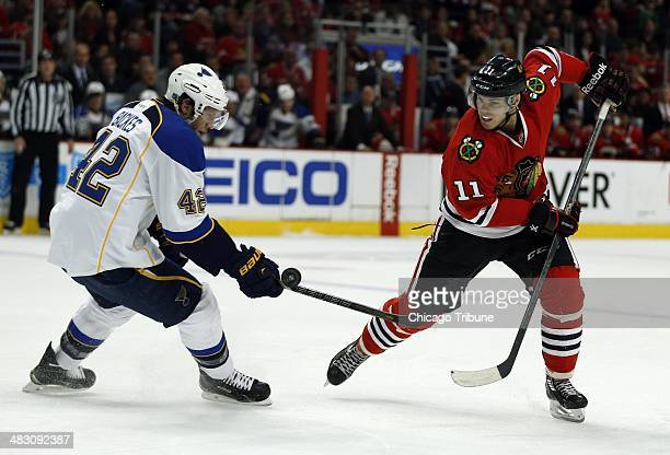 Chicago Blackhawks' Jeremy Morin battles St Louis Blues' David Backes in the 1st period at the United Center in Chicago on Sunday April 6 2014