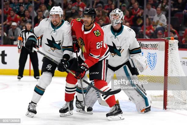 Chicago Blackhawks left wing Andreas Martinsen battles with San Jose Sharks defenseman Brenden Dillon and San Jose Sharks goaltender Martin Jones in...