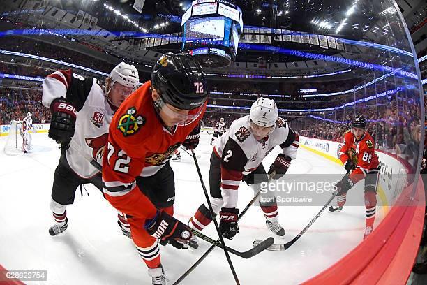 Chicago Blackhawks left wing Artemi Panarin and Chicago Blackhawks right wing Patrick Kane battle with Arizona Coyotes center Christian Dvorak and...
