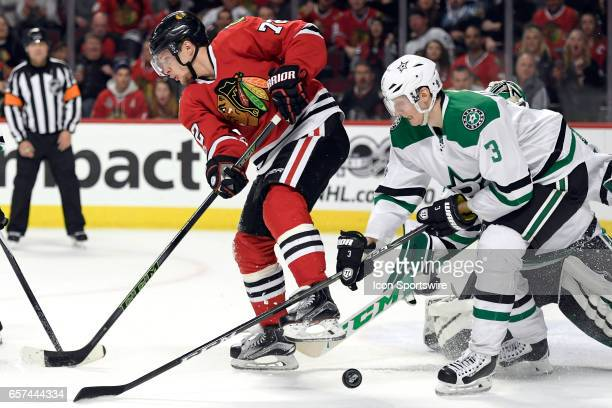 Chicago Blackhawks left wing Artemi Panarin battles with Dallas Stars defenseman John Klingberg for a loose puck during the third period of a game...