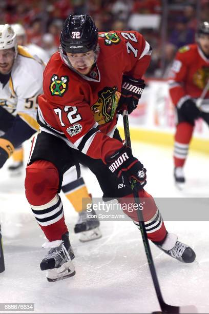 Chicago Blackhawks left wing Artemi Panarin battles with Nashville Predators defenseman Roman Josi for the puck during game 1 of the first round of...