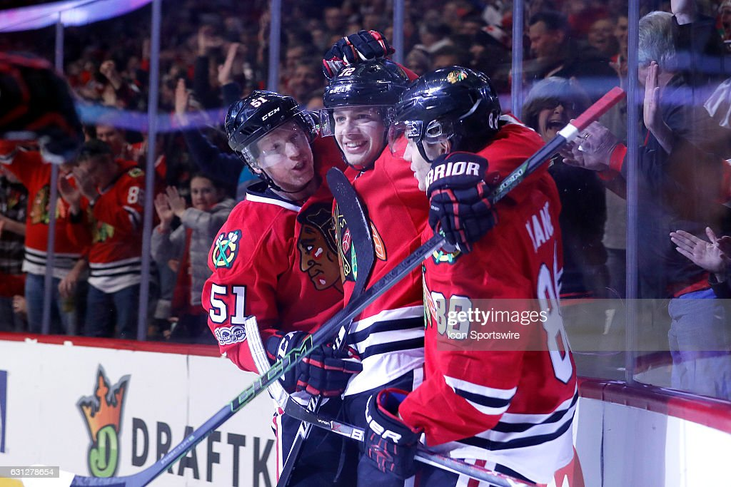 Chicago Blackhawks left wing Artemi Panarin (72) celebrates with Chicago Blackhawks right wing Patrick Kane (88) and Chicago Blackhawks defenseman Brian Campbell (51) after scoring a goal during the first period of a game between the Nashville Predators and the Chicago Blackhawks on January 08, 2017, at the United Center in Chicago, IL. The Chicago Blackhawks defeated the Nashville Predators by the score of 5-2.