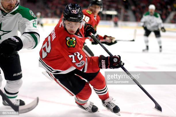 Chicago Blackhawks left wing Artemi Panarin skates to chase a loose puck during the first period of a game between the Chicago Blackhawks and the...