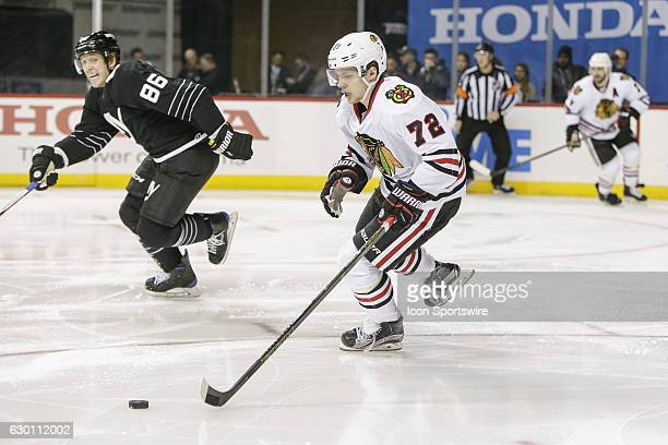 Chicago Blackhawks Left Wing Artemi Panarin skates with the puck as New York Islanders Winger Nikolay Kulemin jumps into the play during the Chicago...