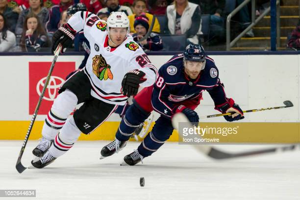 Chicago Blackhawks left wing Brandon Saad and Columbus Blue Jackets center Boone Jenner sprint for the puck in the third period of a game between the...