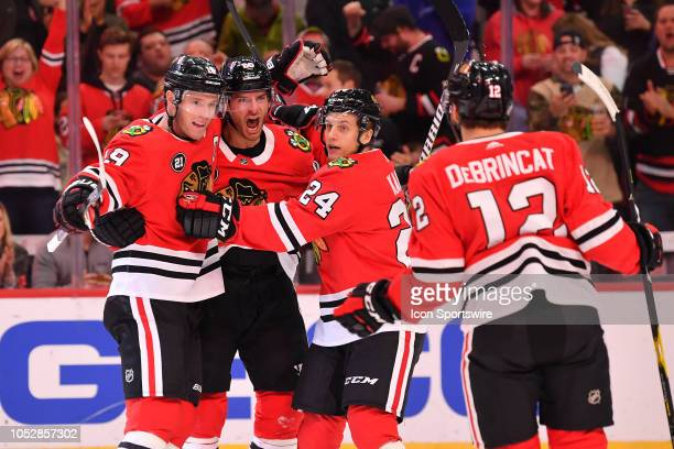 Chicago Blackhawks left wing Brandon Saad celebrates his goal with teammates in the first period of game action during a NHL game between the Chicago...