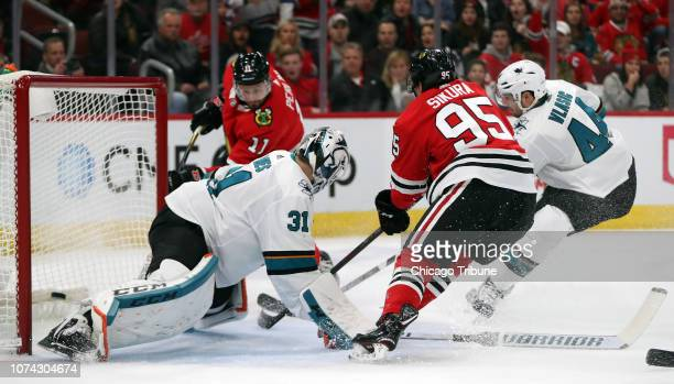 Chicago Blackhawks left wing Brendan Perlini scores on a rebound from Dylan Sikura against San Jose Sharks goaltender Martin Jones in the first...