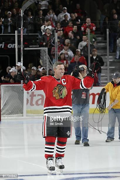 Chicago Blackhawks Legend Denis Savard skates onto the ice during the Blackhawks home opener ceremony against the Colorado Avalanche on October 10...