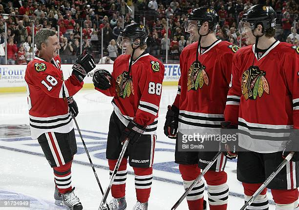 Chicago Blackhawks Legend Denis Savard skates up to Patrick Kane of the Blackhawks during the Blackhawks home opener ceremony against the Colorado...