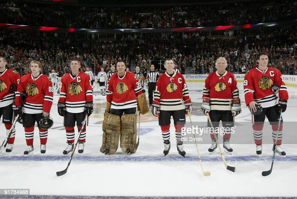 Chicago Blackhawks Legends Denis Savard, Tony Espositio, Stan Mikita, and Bobby Hull stand in between Patrick Kane and Jonathan Toews during the...