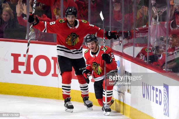 Chicago Blackhawks right wing Alex DeBrincat celebrates with Chicago Blackhawks center Nick Schmaltz and teammates after scoring a goal in the first...