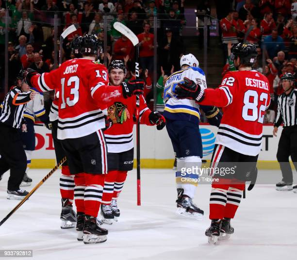 Chicago Blackhawks right wing Alex DeBrincat center celebrates with teammates after his second goal against the St Louis Blues during the first...
