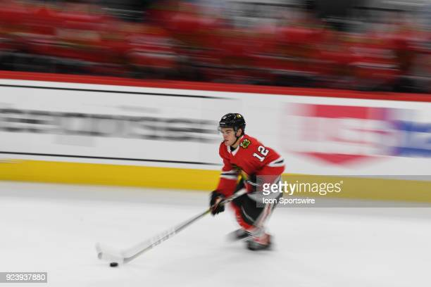Chicago Blackhawks right wing Alex DeBrincat controls the puck during a game between the Chicago Blackhawks and the San Jose Sharks on February 23 at...