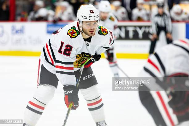 Chicago Blackhawks Right Wing Alex DeBrincat prepares for a faceoff during second period National Hockey League action between the Chicago Blackhawks...