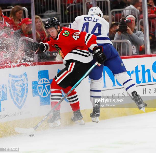 Chicago Blackhawks right wing John Hayden and Toronto Maple Leafs defenseman Morgan Rielly during the first period of their game at the United Center...