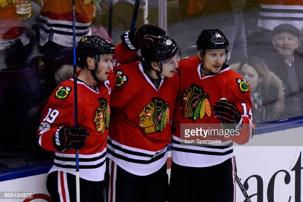 Chicago Blackhawks Right Wing John Hayden celebrates after scoring his first goal of the season with Chicago Blackhawks Center Jonathan Toews and...