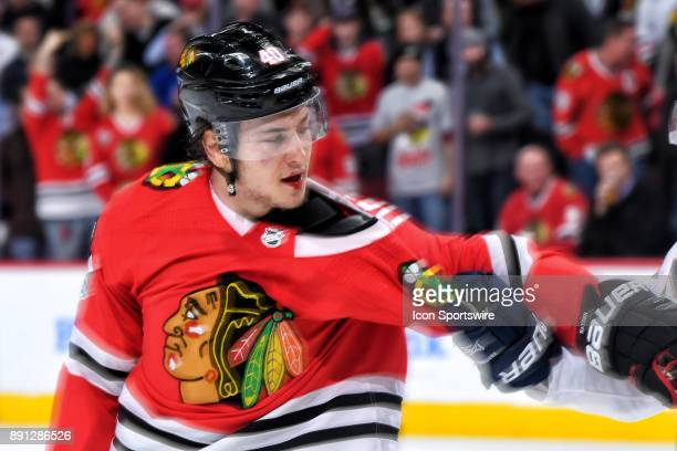 Chicago Blackhawks right wing John Hayden is seen with a cut lower lip after getting into a scuffle with Florida Panthers defenseman MacKenzie Weegar...