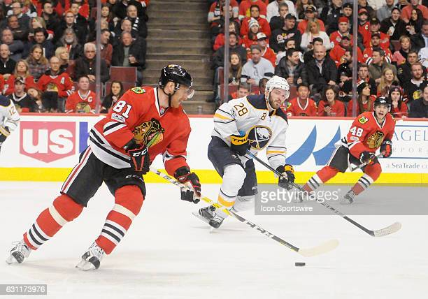 Chicago Blackhawks Right Wing Marian Hossa controls the puck against Buffalo Sabres Winger Zemgus Girgensons on January 05 at the United Center in...