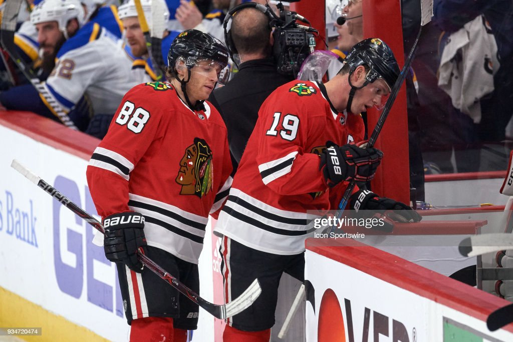 Chicago Blackhawks right wing Patrick Kane (88) and Chicago Blackhawks center Jonathan Toews (19) skate back to the benches during the game between the Chicago Blackhawks and the St. Louis Blues on March 18, 2018, at the United Center in Chicago, Illinois.