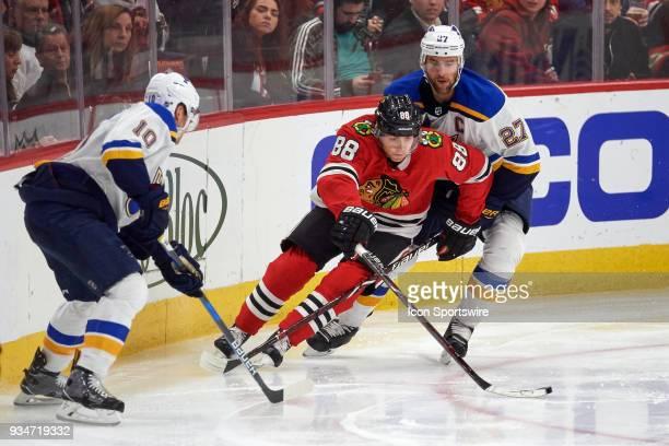 Chicago Blackhawks right wing Patrick Kane battles with St Louis Blues center Brayden Schenn and St Louis Blues defenseman Alex Pietrangelo for a...