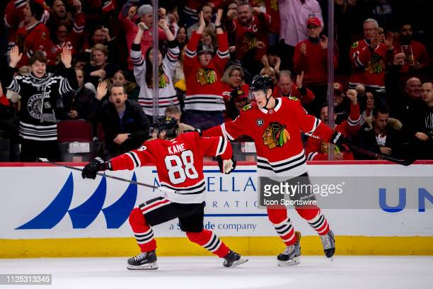 Chicago Blackhawks right wing Patrick Kane celebrates his goal with defenseman Connor Murphy during a game between the New Jersey Devils and the...