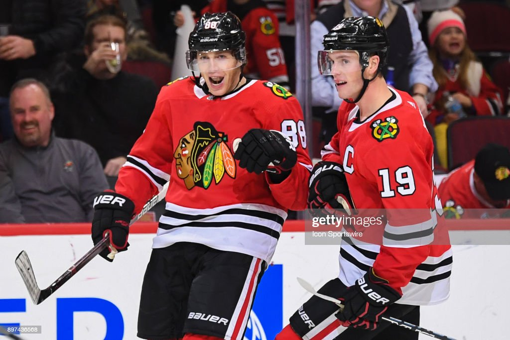 Chicago Blackhawks right wing Patrick Kane (88) celebrates his goal with center Jonathan Toews (19) during the second period during a game between the Chicago Blackhawks and the Minnesota Wild on December 17, 2017, at the United Center in Chicago, IL.