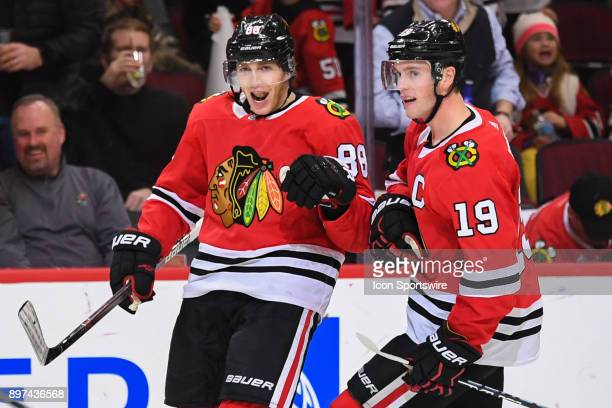 Chicago Blackhawks right wing Patrick Kane celebrates his goal with center Jonathan Toews during the second period during a game between the Chicago...