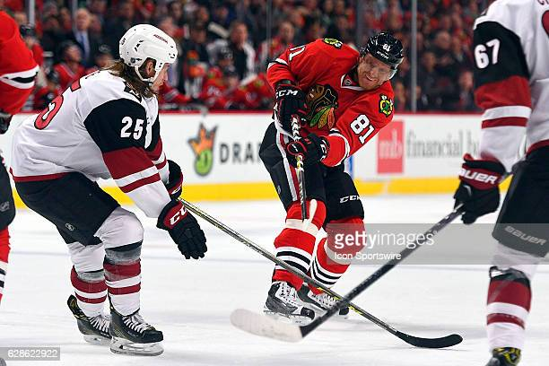 Chicago Blackhawks right wing Patrick Kane takes a shot past Arizona Coyotes center Ryan White during the first period of an NHL game between the...