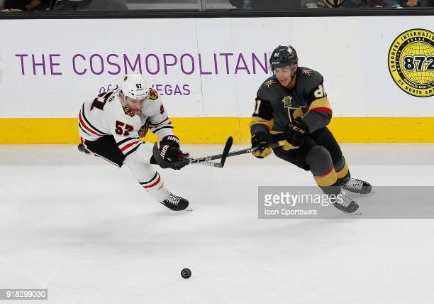 Chicago Blackhawks right wing Tommy Wingels and Vegas Golden Knights center Jonathan Marchessault battle for control of the puck during the third...