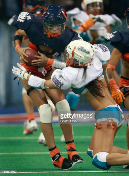 Chicago Bliss' quarterback Ellie Cartabiano tries to avoid Miami Caliente's Annette Mascaro during first half play of the opening game of the...