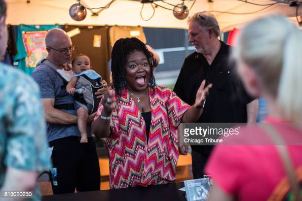 Chicago blues singer Shemekia Copeland talks with fans after her performance at Blues on the Fox festival at RiverEdge Park in Aurora on Friday June...