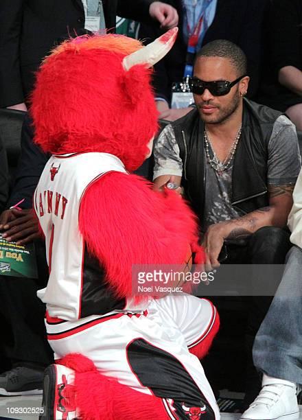 Chicago Bull mascot 'Benny the Bull' speaks to singer Lenny Kravitz during NBA AllStar Saturday night presented by State Farm at Staples Center on...