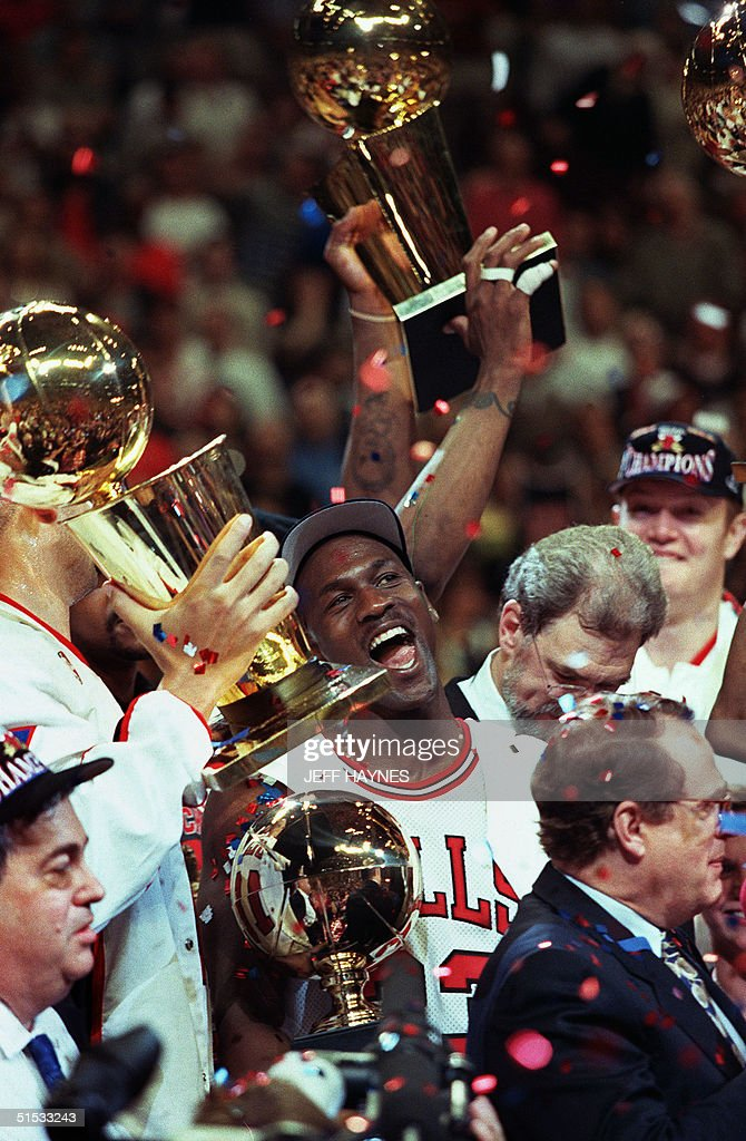 Chicago Bull Player Michael Jordan C Is Surrounded By NBA Championship Trophies After His