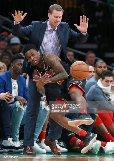 Chicago Bulls' Antonio Blakeney crashes into his head coach Fred Hoiberg as he chases down a second half loose ball. The Boston Celtics host the...