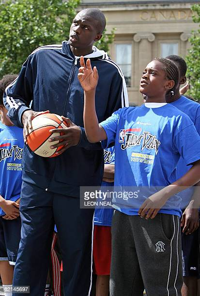 Chicago Bulls basketball player Luol Deng talks to a young player during an NBA JamVan press event in Trafalgar Square in London on August 1 2008...