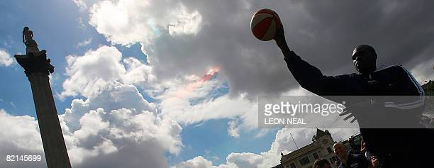 Chicago Bulls basketball player Luol Deng throws the ball during an NBA JamVan press event in Trafalgar Square in London on August 1 2008 British...