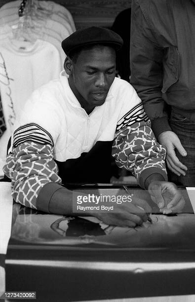 Chicago Bulls basketball player Michael Jordan signs autographs and greets fans at Sportmart in Chicago, Illinois in April 1988.
