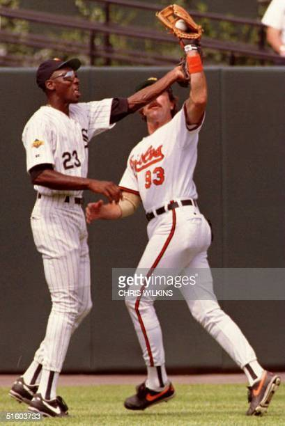 Chicago Bulls basketball player Michael Jordan tries to get the baseball away from actor Tom Selleck 12 July 1993 during festivities leading up to...
