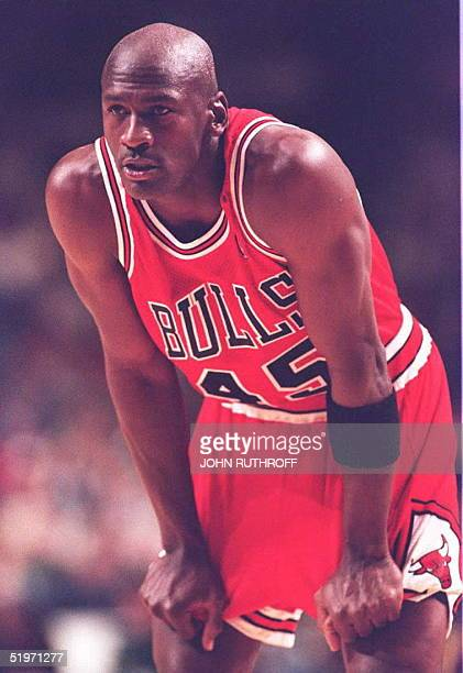 Chicago Bulls basketball star Michael Jordan catches his breath early in the first quarter 19 March at Market Square Arena in Indianapolis Indiana...
