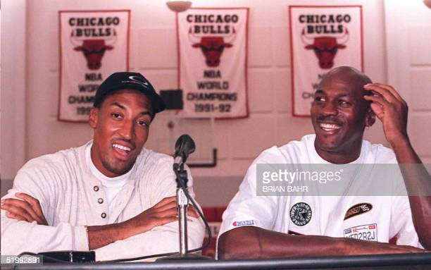 Chicago Bulls basketball stars Michael Jordan and Scottie Pippen laugh at a question about their newly aquired teammate Dennis Rodman before their...