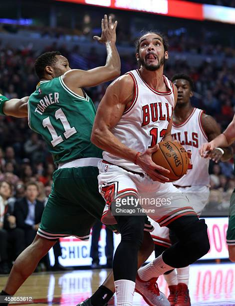 Chicago Bulls center Joakim Noah puts a spin move on Boston Celtics guard Evan Turner before scoring during the first half on Saturday Nov 8 at the...