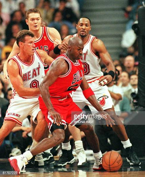 Chicago Bulls Center Luc Longley Watches As Teammate